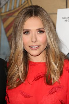 Try Elizabeth Olsen's sexy smoky eyes by sweeping a burnt copper hue across the lid. Define with a shimmery brown liner and blend with your fingers for an sexy, imperfect result. Add a coat of black, volumizing mascara and a hint of bronze blush on the cheeks. Complete with a matte, peachy brown lip.