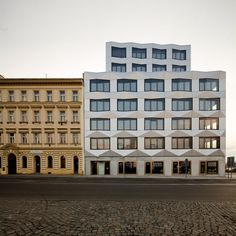 Futuristic vs Englishy, 3-D vs 3-D by Keystone Office Building / EM2N Architects