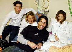Rare Photos of Cristiano Ronaldo:     2003:   Cristiano Ronaldo and Manchester United teammates Diego Forlan and Ruud van Nistelrooy pose with Casey Ogden during the players' annual visit to children's hospitals in Manchester.