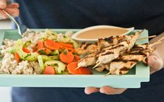 Creamy coconut rice and tangy cucumber salad make delicious partners to chicken satay served with a rich peanut sauce.