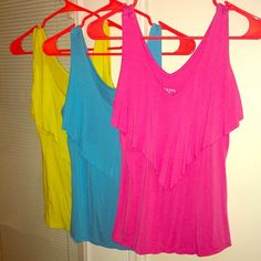 Set of 3 Wardrobe Essential tops in vibrant colors Set of 3 -- Wardrobe Essential identical tops in 3 vibrant colors. From Target never worn and now are too small for me. Super comfortable stretchy material 95% rayon 5% spandex Merona Tops