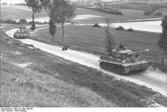 Tiger I heavy tanks of the German 1st SS Division Leibstandarte SS Adolf Hitler on a country road in Northern France, spring 1944, photo 1 of 2