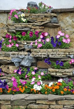 flower bed designs with bricks | The stone flower bed on the wall | Stock Photo © Olga Volodina ...