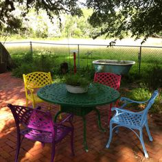 Brighten your old outside furniture! Each family member choose their favorite color and spray painted their chair.