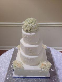 Different shapes and details make for an elegant wedding cake.