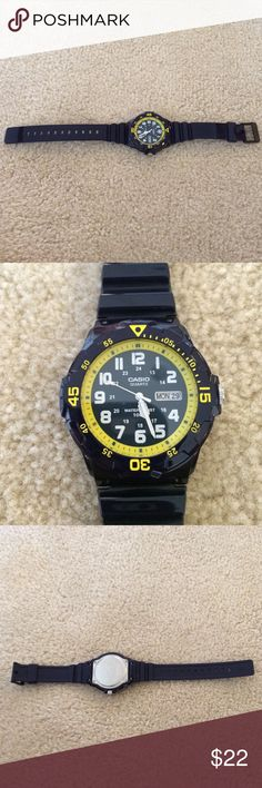 Casio watch Navy blue & yellow Casio watch. Worn twice excellent condition. Stainless steel back, water resistant. Accessories Watches