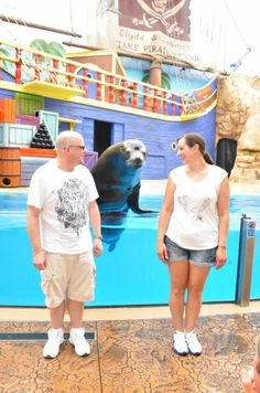 """Victoria H.and her boyfriend making a new friend at """"Sea Lions Up-Close Tour"""" at SeaWorld Orlando"""