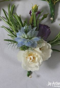 Google Image Result for http://www.jayarcherfloraldesign.com/wp-content/uploads/2012/07/Groom-buttonhole.jpg