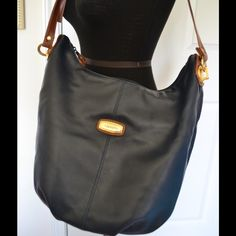 "Capezio large bucket bag Beautifully made Capezio bucket or Feed bag. Measures 16"" x 10"" shoulder drop 22"" and is adjustable. Navy blue and brown color, faux leather. Gold toned hardware. Very clean and in excellent condition! capezio Bags"