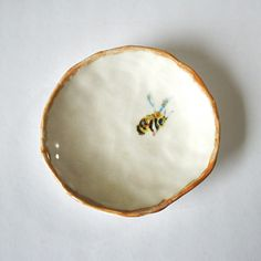 Hand crafted porcelain bee dish by YesterNow on Etsy https://www.etsy.com/listing/230465870/hand-crafted-porcelain-bee-dish