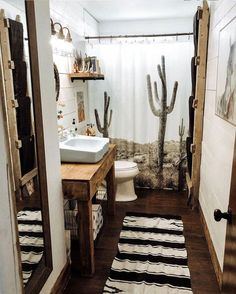 From the rustic hints, to the cactus shower curtain, all the way to the robin's egg blue sink, this southwestern style bathroom is nothing short of perfect! Western Bathroom Decor, Western Bathrooms, Western Rooms, Farm Style Bathrooms, Rustic Western Decor, Home Decor Styles, Diy Home Decor, Decor Crafts, Cactus Shower Curtain