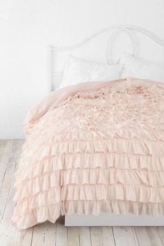 love this beautiful calm pink bed spread  all the white in this room