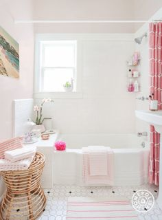Inspiration Roundup: Beautiful Bathrooms - For the girly glamazon, buy everything in pink and call it a day. Wicker baskets look good and keep things tidy, and white detailing in accessories make the pink really pop. - @Homepolish New York City
