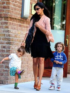 Camila Alves  Out with her daughter, Vida, 2, and son, Levi, 4, Matthew McConaughey's pregnant wife was the picture of mommy chic in a black dress and peach sweater.