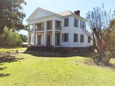 Historic Colonial 2 Story with Front Porch and Large Columns that is on the National Historic Register of Homes. There is also a Guest House with approximately 500 square feet, and a Huge 40' x 50' Barn on the property. All room in this home are Large with 11' Ceilings on the Main Level and most of the rooms Upstairs have 9' Ceilings. Flooring in the home is predominantly Heart of Pine and Windows have been replaced with Insulated Windows. The Attic is Huge with Walk-up Stair. Property is…