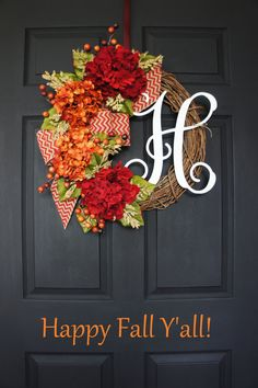 Grace your front door this Fall with this beautiful monogram grapevine wreath decorated with a lush Hydrangea blooms in burnt orange & deep burgundy