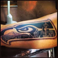 And this Seahawks tattoo combining the logo with the Seattle skyline is truly inspired. | 24 Badass Tattoos That Will Get You Pumped This Football Season