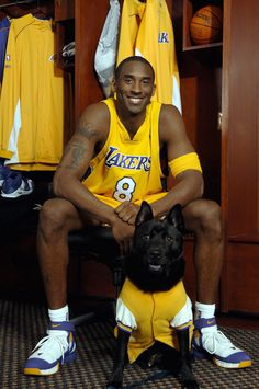 Kobe Bryant of the Los Angeles Lakers poses for the 2005-2006 Lakers Calendar photo shoot September 19, 2005 at the Healthsouth Training Center in El Segundo, California. The Lakers Youth Foundation teamed up with The Amanda Foundation, a nonprofit organization that rescues dogs and cats, to produce the calendar. Proceeds from the calendar go to both charities. (Photo by Andrew D. Bernstein/NBAE via Getty Images; Copyright 2005 NBAE )