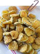 Fried Pickles - Table for Two. Cornmeal, flour, cayenne, garlic powder, paprika breading.