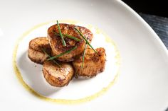 sea scallops: ginger, coconut sauce, curry oil, chives