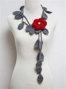 I love this grey vine with red flower necklace!