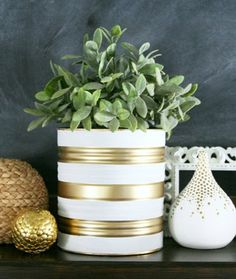 Painted Tin Can Planters: Who knew recycling could be so stylish? Get a jump start on a fun DIY for Earth Day with these chic looking planters made from old tin cans.