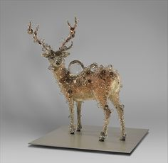 """Kohei Nawa. This taxidermied deer has been completely transformed through the artist's use of variably sized """"PixCell"""" beads, a term he invented. PixCell combines the idea of a """"pixel,"""" the smallest unit of a digital image, with that of a """"cell"""