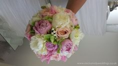 Wedding bouquet roses and peonies