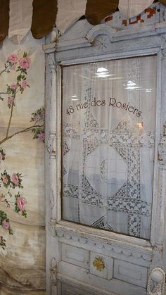 This would be neat as a bathroom door - either an actual lace curtain or that plastic film that presses on.