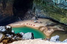 Hang En Cave in Quang Binh Province, Vietnam. Sleep inside the world's third largest cave that has it's own sandy beach, a natural turquoise pool and a ceiling that towers over 300 feet high. This cave's size is only matched by the bigger Deer Cave in Malaysia and Son Doong Cave also in Vietnam.