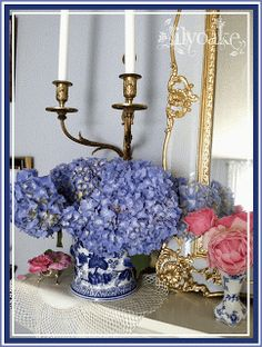 A gilded pale blue mirror frame and blue hydrangeas in a blue & white cache pot, from LilyOake blog