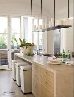 Fairly cheap way to do a waterfall kitchen island with seating, storage, sink and surface space.