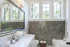 gray subway tile under windows in white bathroom