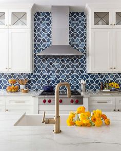 A dramatic kitchen makeover with blue glass tile backsplash, white cabinets and brushed brass faucet Blue Glass Tile, Blue Tiles, Blue Mosaic, Glass Tiles, Cement Tiles, Mosaic Tiles, Wall Tiles, Blue Backsplash, Stacked Stone Backsplash