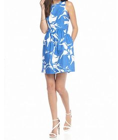A beautifully bold print and figure-skimming silhouette brighten this must-have dress. Elevated by sleek, chic and flattering details you'll love to showcase. Love the French Blue and White floral pattern. It's a perfect dress for a wedding party!