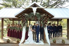Savannah + Jon Paul   Maroon, Navy, Coral & Gold Rustic Wedding    The couple wed atLa Estancia Bella, a charming 100-acre cattle ranch with a custom-built barn venue and expansive views of the Texas Hill Country.  Photo: Dunlap Photography   #countrychic #barnwedding #weddingvenue #rustic #country #cowboy #barn #western #barnreception #texanwedding #outdoorceremony #indoorreception #countryvenue #laceweddingdress #maroonwedding #greenery #eucalyptus #cowskull #countrywedding