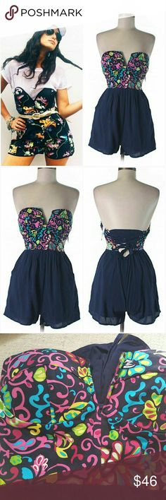 """NWT LF Sweetheart Bustier Romper Aus10 US 4/6 New w/ tags. Fun navy strapless bustier romper. Bold fuschia, yellow, blue, green & white floral print. Side pockets. Modeled & padded cups. Side zip. Stretch in waist & chest band. Custom fit w/ crisscross corset-like back closure. 100% Rayon. $168 at LF. By Angel Biba. Approx 22.5"""" top of cup to hem. Similar romper modeled in pics.   *Sz Aus 10 = S US (4/6). Converted to US sz S in buying options* LF Pants Jumpsuits & Rompers"""