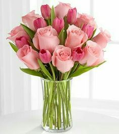 Beauty of pink. Fourteen stems mixed flowers of pink roses & pink tulips in clear glass vase. The beauty of pink flowers are available in this floral arrangement. Tulips In Vase, Pink Tulips, Flower Vases, Pink Flowers, Roses Vase, 12 Roses, Bouquet Flowers, Arrangements Ikebana, Floral Arrangements