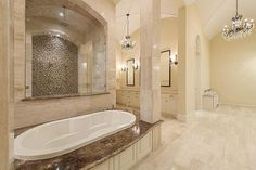 5559 Holly Springs Dr Houston, TX 77056: Photo Marble Master Bath with his and her walk-in closets, water closets, and vanities