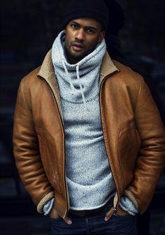 Shop this look on Lookastic:  http://lookastic.com/men/looks/black-beanie-grey-hoodie-tan-shearling-jacket-navy-skinny-jeans/8998  — Black Beanie  — Grey Knit Hoodie  — Tan Shearling Jacket  — Navy Skinny Jeans