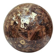 Resin sphere composed of miscellaneous vintage hardware parts
