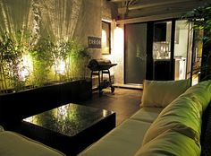 I just love the use of plants infused with the lighting.  It adds a beautiful green glow that seems warm but mysterious.  Hong Kong Apartment by OneByNine