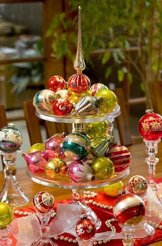 Vintage ornaments on tiered cake stands w/topper - love it!