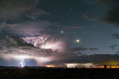 A powerful storm hammers the landscape around Utah's Arches National Park. Astrophotographer David Lane captured this striking shot of multiple lightning strikes. Balanced Rock is visible in the lower right, while Venus (brightest lower right) and Jupiter (middle) and the blue star Regulus (upper left) are shrouded in a bit of clouds. Photo courtesy of David Lane. — with Dave Lane Astrophotography at Arches National Park.