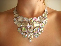 A handmade crystal clear aurora borealis rhinestone bib necklace. A beautiful statement necklace that would look lovely for brides that are