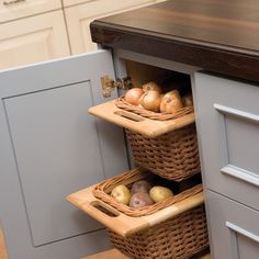 Kitchen - dark storage idea for produce - install runners in a cabinet, use cutting board for base, & hang basket from the inside. cool!