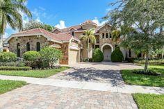 Beautiful home in prestigious Versailles in Wellington, FL.  $689,900 -  5 Bedrooms, Den, Loft, 4 1/2 Baths, & 3 car garage with long lake view l