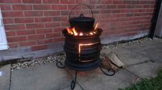 Wood Burning Stove - Made from two welded wheel rims, by Twilight's Forge