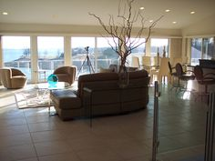 From foyer facing Family Room, Dining Room and through windows to lake.