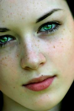 Freckles and green eyes